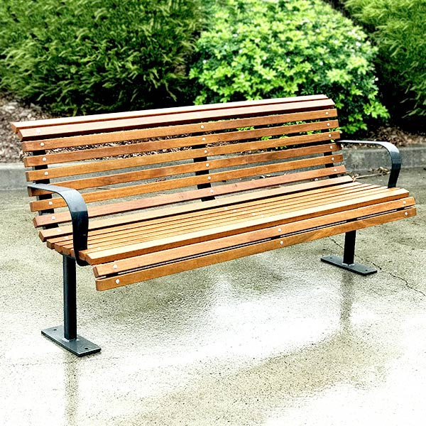 Curved timber seat for parks and recreational areas